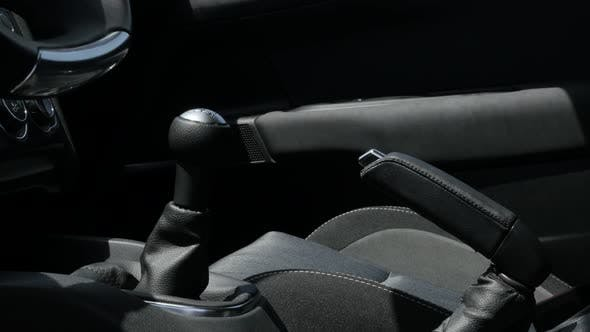 Thumbnail for Manual gear stick and interior of modern vehicle 4K 2160p 30fps UltraHD tilting footage - Details in