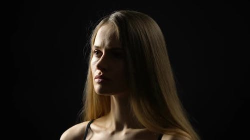 Pensive Young Woman Isolated on Dark Background, Self-Esteem Problem, Complex