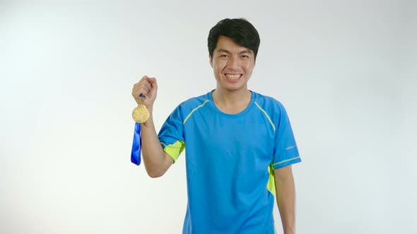 Asian Man Showing His Golden Medal
