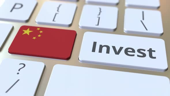 INVEST Text and Flag of China on the Keyboard