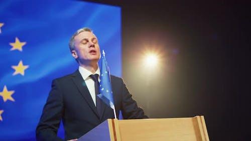 Mature Politician Giving Encouraging Speech From Rostrum