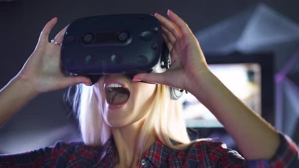 Modern Interactive Technologies, Female Puts on Virtual Reality Glasses, Exploring the Virtual Space