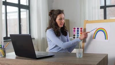 Teacher with Colors Having Online Class of Arts