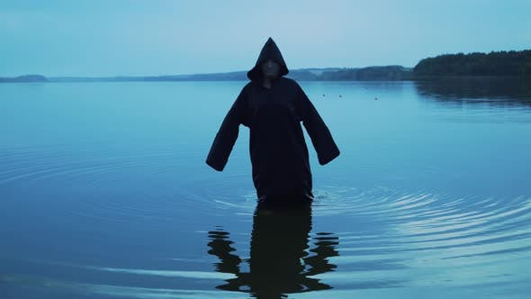 Thumbnail for Evil Witch in Black Cloak with Hood in the River
