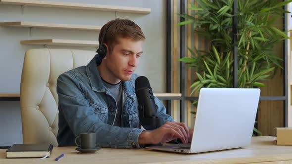 Radio Host Concept - Portrait Handsome Man Sitting in Front of Microphone