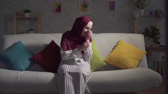 Young Muslim Woman Depression Crying Sitting Couch Living Room