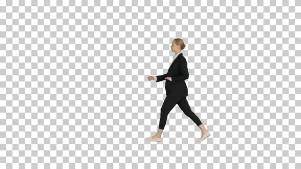 Gorgeous blond fashionable businesswoman walking by, Alpha Channel