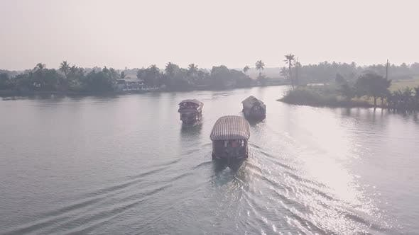 Houseboat trip of Kerala backwaters at Alleppey, India. Aerial drone view