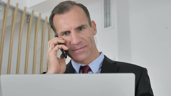 Thumbnail for Middle Aged Businessman Talking on Phone Negotiating with Customer