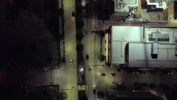 Thumbnail for Birds Eye View On Downtown City Streets Alive With Cars Driving At Night