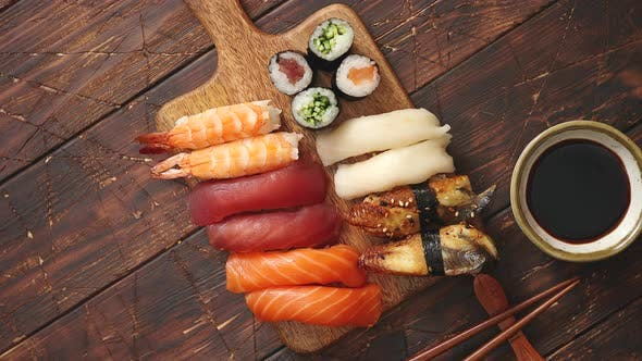 Thumbnail for Sushi Set. Different Kinds of Sushi Rolls on Wooden Serving Board