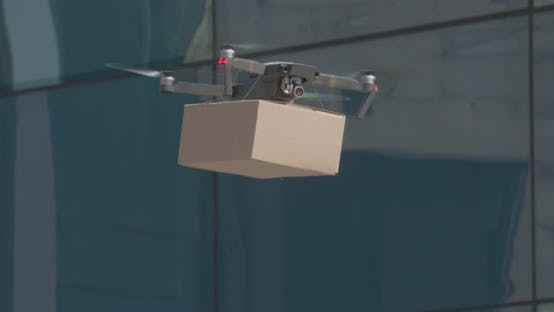 Thumbnail for Drone Lifting Up Carton Package in Empty City
