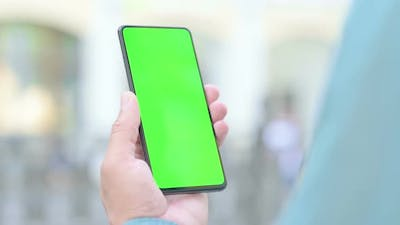 Outdoor Man Holding Smartphone with Green Chroma Key Screen