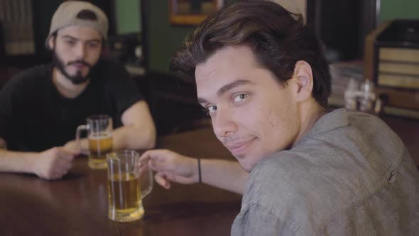 Thumbnail for Two Men Sitting in the Bar Drinking Beer Together