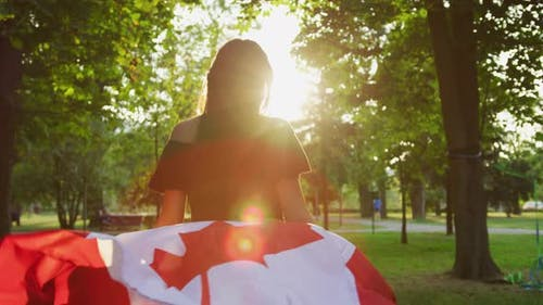 Girl running with the Canadian flag