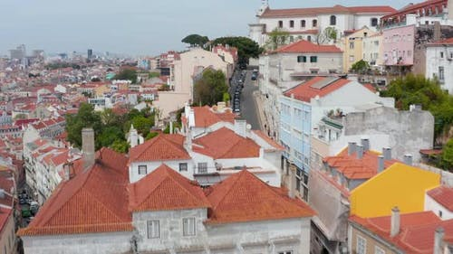 Aerial View of Steep Hills Full of Residential Colorful Houses and Narrow Streets in Urban City