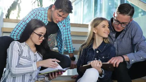 Students Studying, Reading Educational Book In College