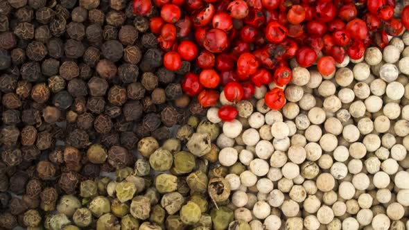 Thumbnail for Top View From Above of a Heap of White, Black, Green and Pink Pepper Peppercorns