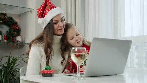 New Year's Concept Mom Her Daughter Christmas Costumes Make Online Call Laptop