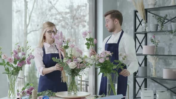 Relationship Work, Young Happy Employees Flower Shop Florists Are Diligently Striving To Create