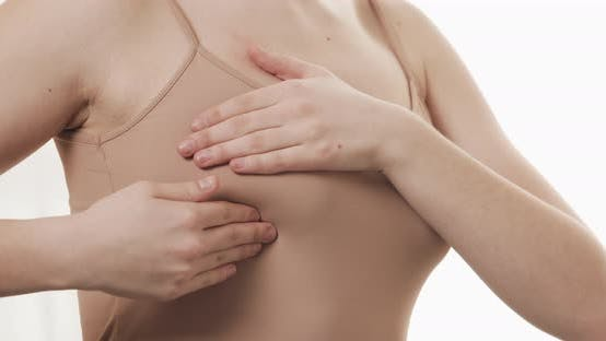 Thumbnail for Woman Checking Her Breast for Signs of Breast Cancer
