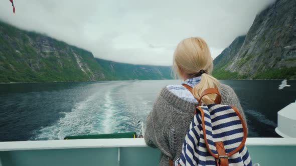 Thumbnail for Tourist Woman Admiring the Picturesque Norwegian Fjord From the Stern of a Cruise Ship