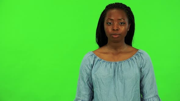Thumbnail for A Young Black Woman Agrees at the Camera with a Smile - Green Screen Studio