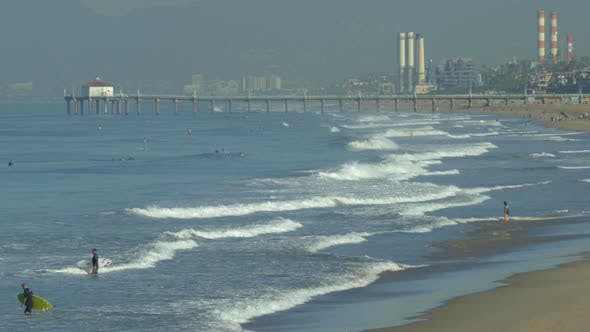 Thumbnail for The Manhattan Beach Pier in California extends into the Pacific Ocean.