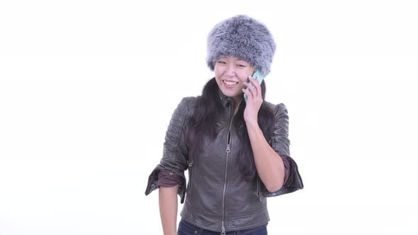 Thumbnail for Happy Beautiful Asian Woman Talking on the Phone