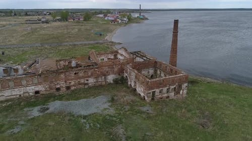 Aerial view of old brick ruined building with a brick pipe