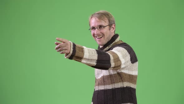 Thumbnail for Profile View of Happy Handsome Man Pointing Finger