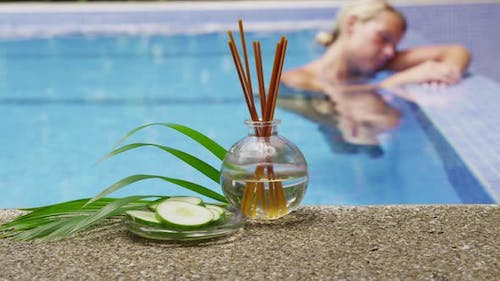 Tropical spa with woman in pool. Shot on RED EPIC for high quality 4K, UHD, Ultra HD resolution.