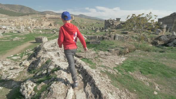 Thumbnail for Child Discovering Ancient City and Walking Among the Ruins. Pamukkale, Turkey