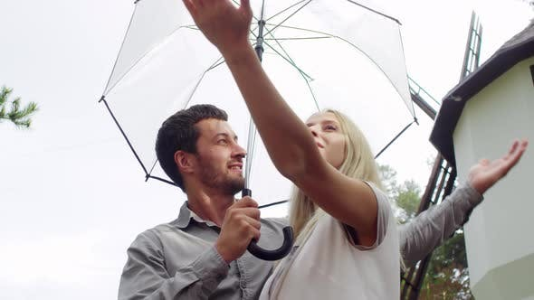 Thumbnail for Couple Standing under Umbrella on Rainy Day