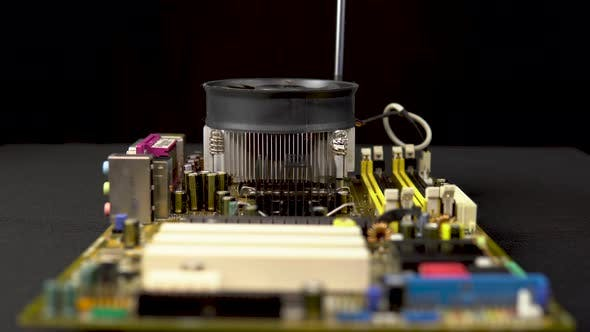 Thumbnail for Removes a Processor Cooler From the Motherboard. CPU Cooling System on Pc. View of the Disassembled