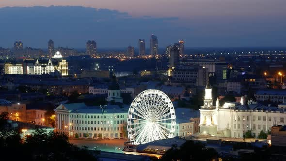 Thumbnail for Time Lapse of Rotating Ferris Wheel in Kiev. Contract Square in Podil District with Spectacular
