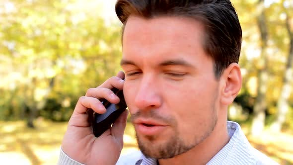 Cover Image for View on a Young Handsome Man Who Talks To Somebody on the Phone - Detail of Face Expression