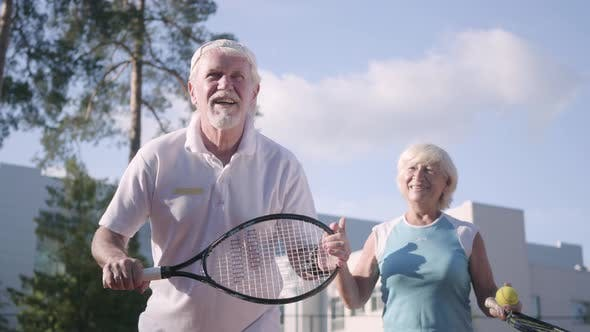 Cover Image for Adult Couple Playing Tennis on a Sunny Day