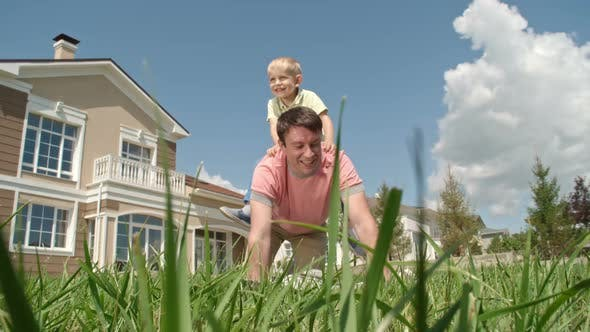 Cover Image for Happy Boy Riding on Back of Daddy