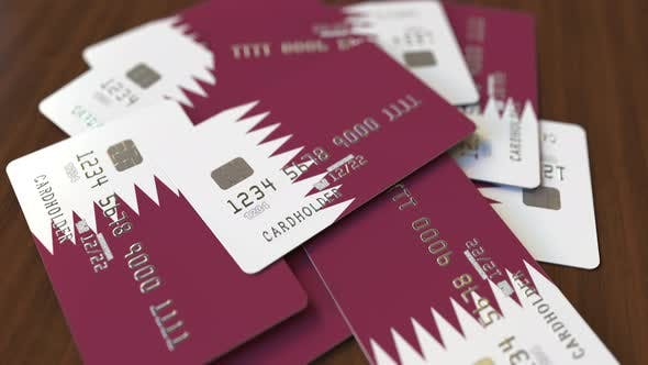 Thumbnail for Pile of Credit Cards with Flag of Qatar