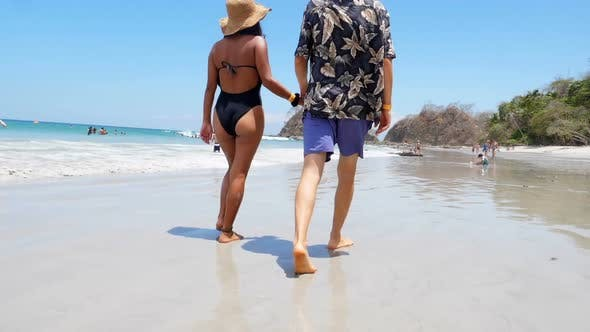 Thumbnail for Couple Walking on White Sand Beach in the Caribbean