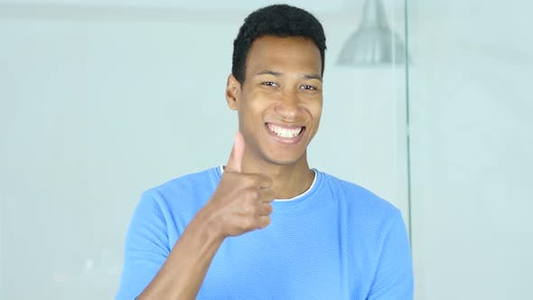 Thumbnail for Thumbs Up by Happy Young Afro-American Man