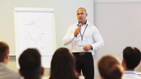 Thumbnail for Speaker with Microphone at Business Conference