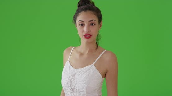 Thumbnail for A Latin woman poses for a portrait in a sun dress on green screen