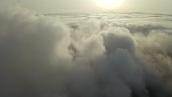 Thumbnail for Flying Over the Evening Clouds with the Late Sun.
