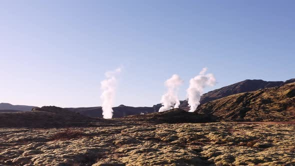 Drone Of Steam Rising Into Blue Sky From Thermal Pools