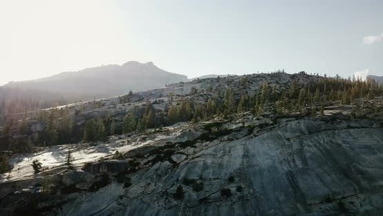Thumbnail for Drone Flying Over Amazing White Mountain Rocky Ridge Covered with Pine Forest at Sunny Yosemite