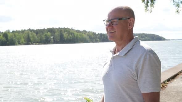 Thumbnail for Happy Senior Man Thinking By The Lake