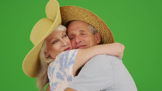 Thumbnail for Closeup of happy seniors on vacation hugging and dancing on green screen
