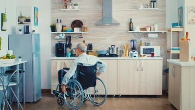 Handicapped Man Opening Refrigerator